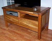 "Television table in ""Herbie"" elm and cherry, with ebony accents"