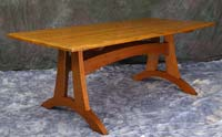 "Dining table, 84"" x 40"", cherry base, figured teak top"